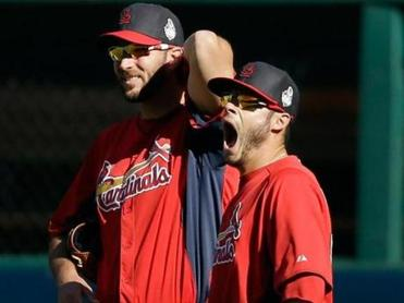 Joe Kelly yawns during the Cardinals' practice Sunday while standing next to fellow pitcher Adam Wainwright.